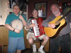 The Dossers are, L to R, Rick Marquis on vocals, banjo, and mandolin, Gene Christy on vocals and Roland all-digital accordion, and Bill Morrison, on vocals and rhythm guitar