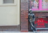 12790382-john-lennon-statue-outside-the-cavern-club-in-mathew-st-liverpool-uk