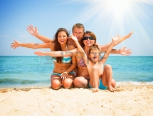 21289418-happy-family-having-fun-at-the-beach-vacation-concept